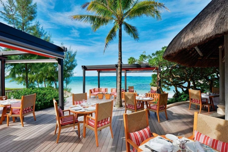 Dining terrace on the beach at Constance Belle Mare Plage
