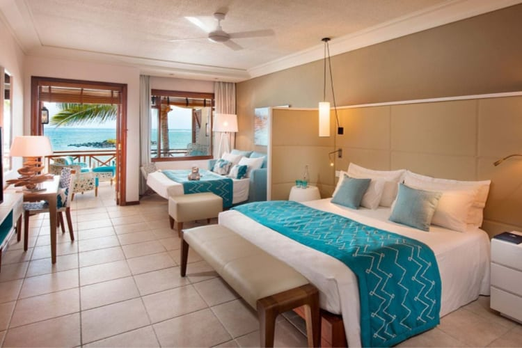 Bedroom with double bed and sofa bed of Constance Belle Mare Plage
