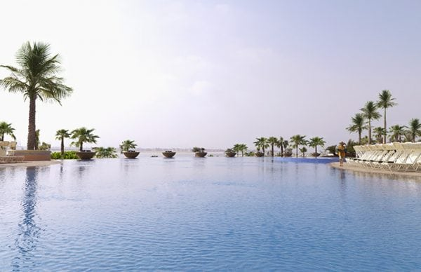 Infinity pool surrounded with palm trees