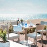 Terrace by the beach at Ikos Aria