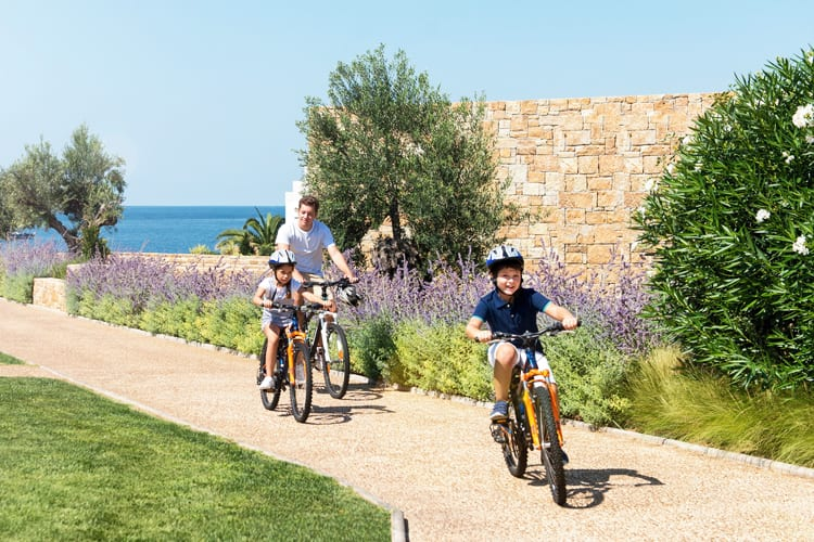 children biking at ikos aria