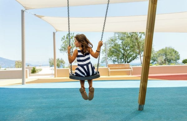 Little girl plays in the playground at Ikos Dassia