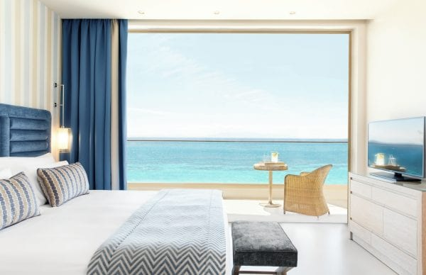 Bedroom with sea view at Ikos Oceania