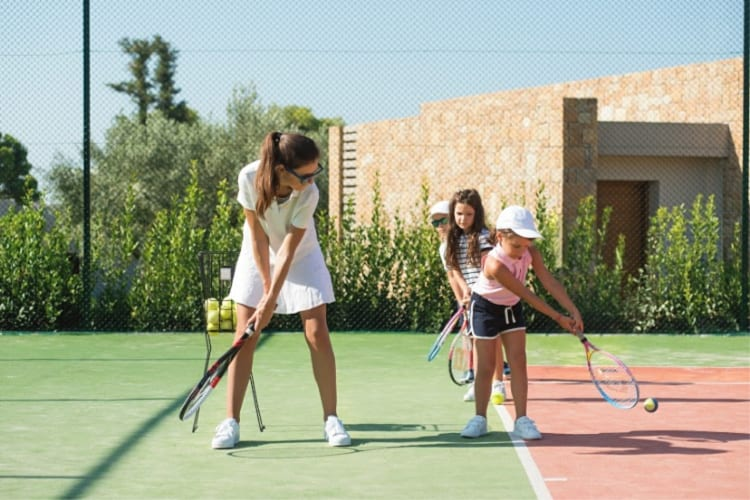Tennis session with children at Ikos Oceania