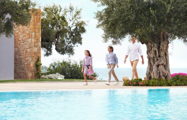 Family walk near the pool of Ikos Oceania
