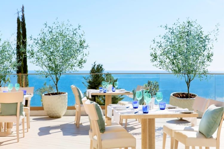 The outdoor tables of the Italian restaurant Fresco at Ikos Oceania