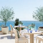 Outdoor tables of the Italian restaurant Fresco at Ikos Oceania