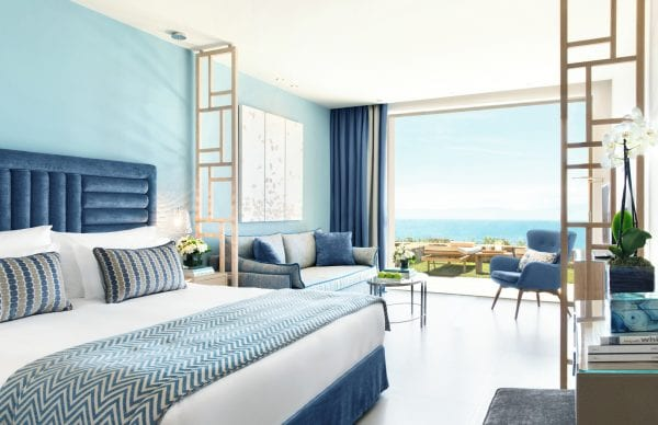 Junior Suite combines bedroom and living room with a private garden and panoramic view in Ikos Oceania