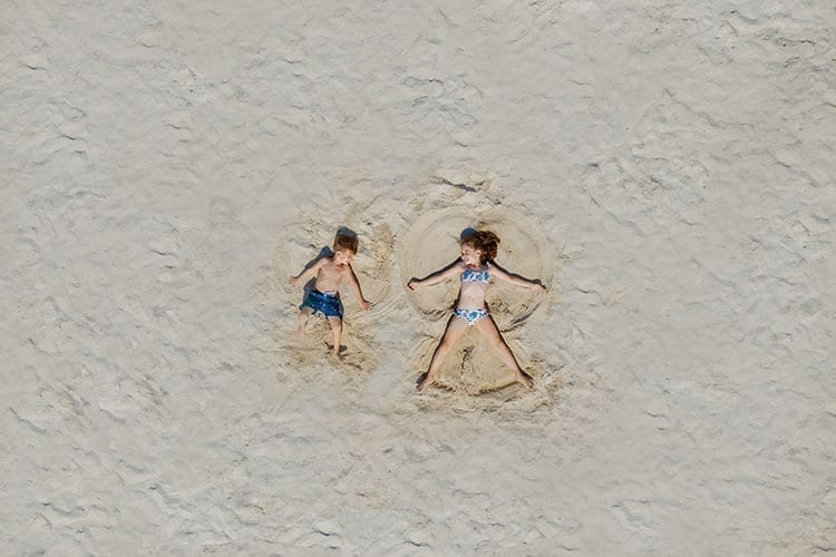 Kids playing in the sand at Porto Sani
