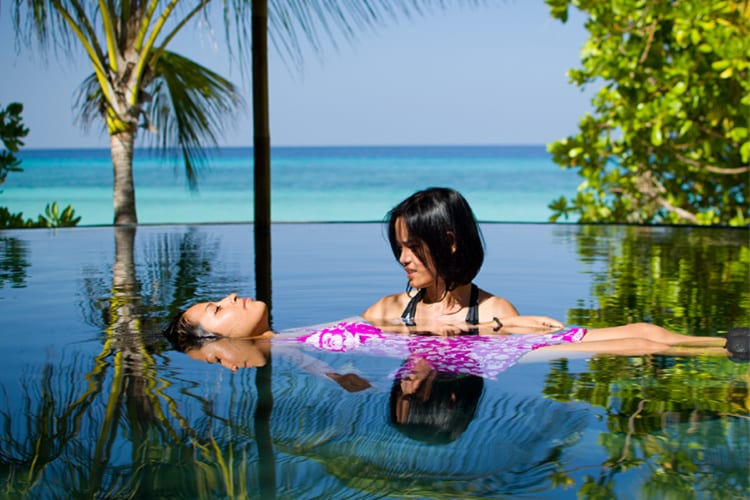 One & Only Reethi Rah Relaxing moment in the pool