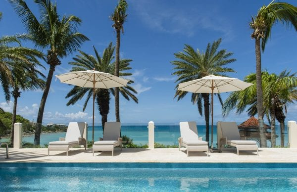 Blue Waters Resort & Spa swimming pool with deckchairs and umbrellas