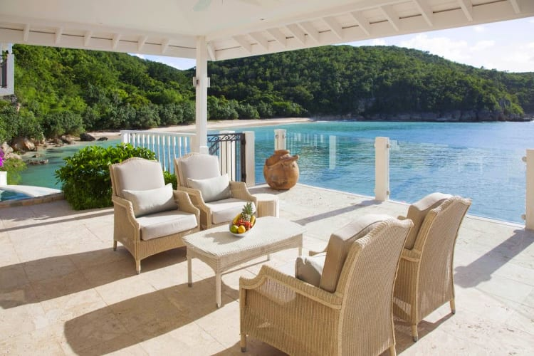 Outdoor lounge with sea view at Blue Waters Resort & Spa