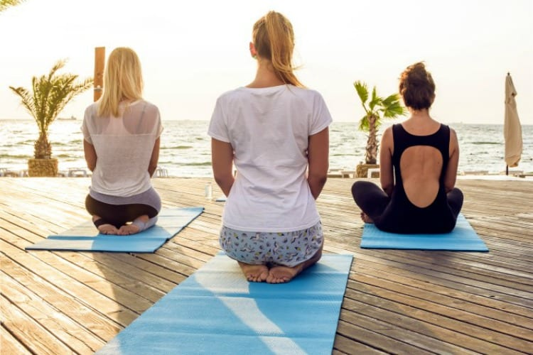 A yoga session by the sea at Blue Waters Resort & Spa