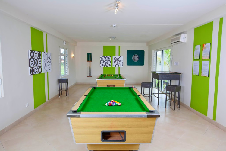 Pool tables in the game room of the Lux Tamassa