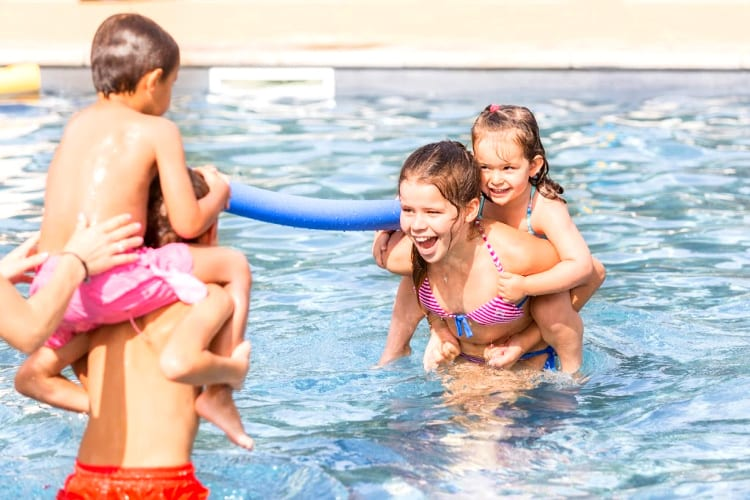 Kids play on the swimming pool at the Terre Blanche hotek