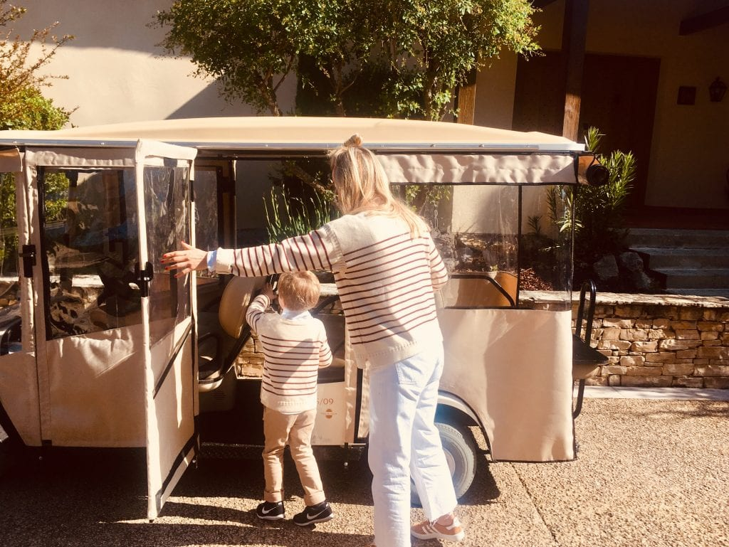 A mother and her baby boy discover their buggy at Terre Blanche Hotel Spa Golf Resort