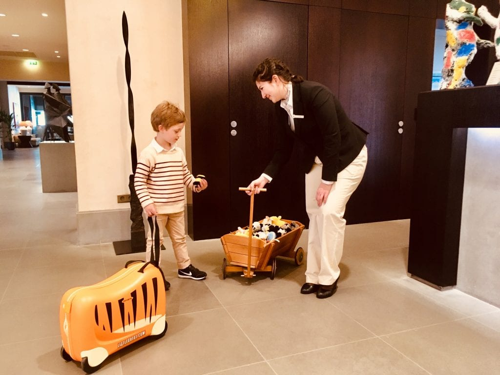 A kid plays at the check-in desk of the Terre Blanche Hotel Spa Golf Resort