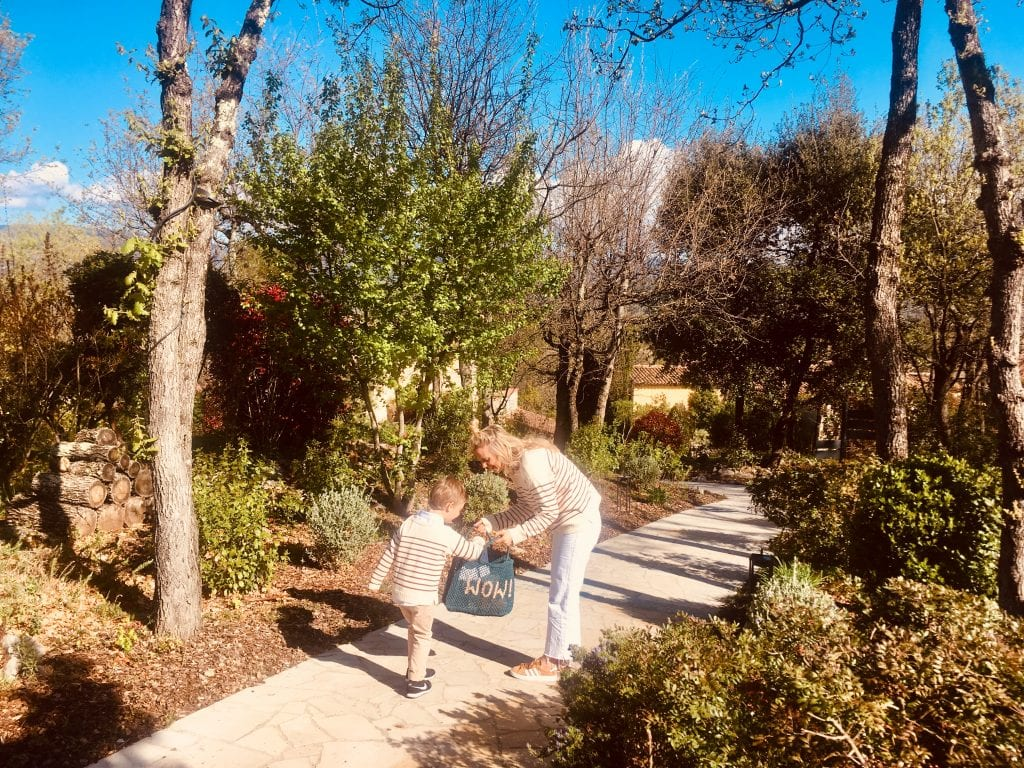 A mother and her son play in the gardens of the Terre Blanche Hotel Spa Golf Resort