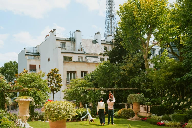 Shangri-La Paris Family playing in the garden of the hotel