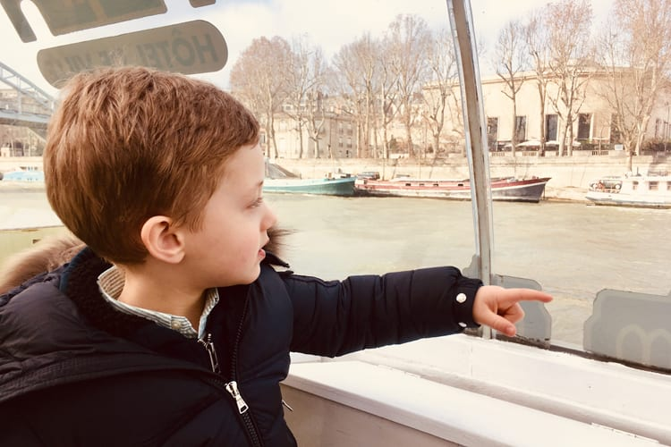 Shangri-La Paris Boy discovering Paris by boat