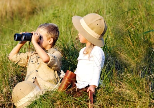 Kids with binoculars in the bush in Circuit Safari