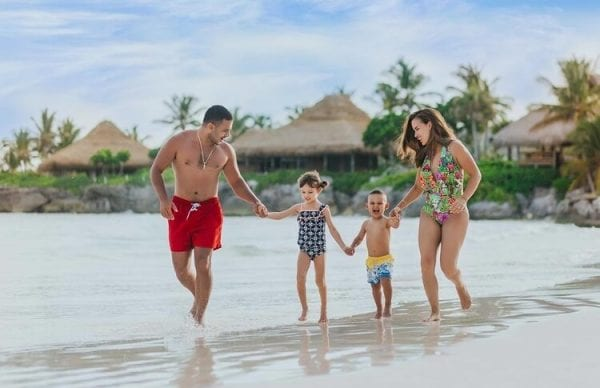 Family playing in the sand Eden Roc Cap Cana