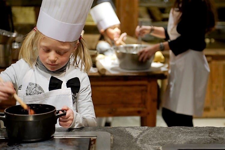 Little Girl cooking at Les Fermes de Marie