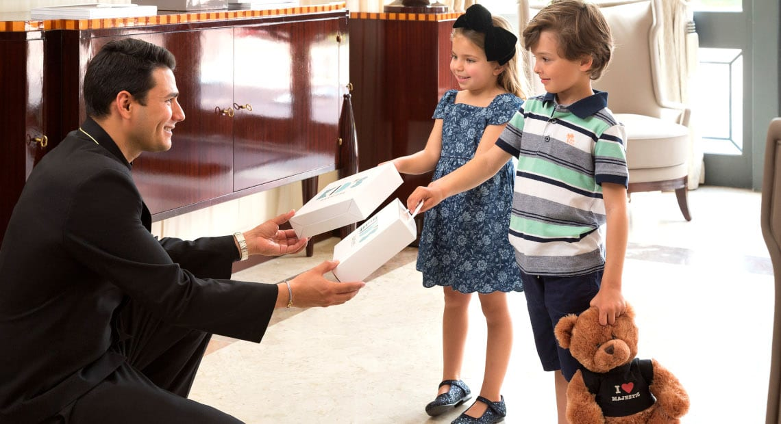 Kids receive gifts at the Hotel Barrière Le Majestic Cannes