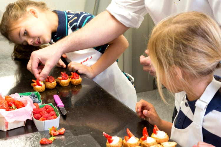 Kids make pasteries at the kids' club of the Hotel Barriere Majestic Cannes