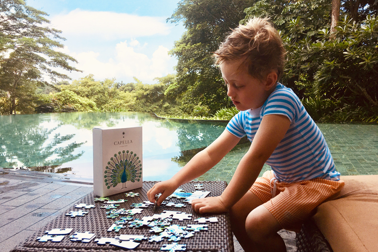 Kid making a puzzle at Capella Singapore