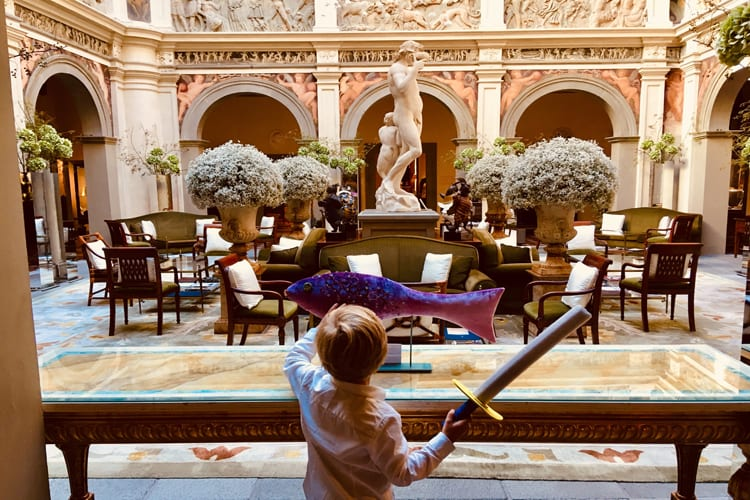 Kid playing in the lobby at Four Seasons Hotel Firenze