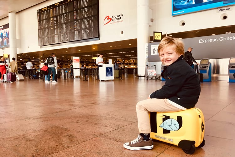 Kid on his Samsonite baggage at the airport