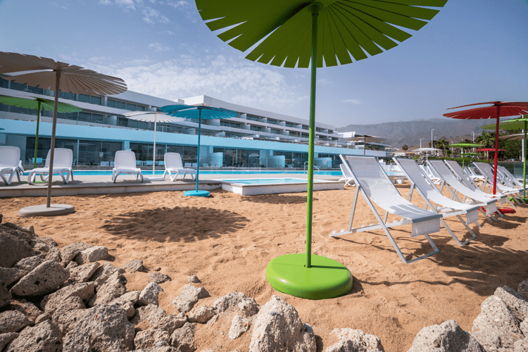 Baobab Suites beach with umbrellas and deckchairs