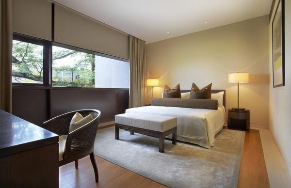 Bedroom with double bed at Capella Singapore