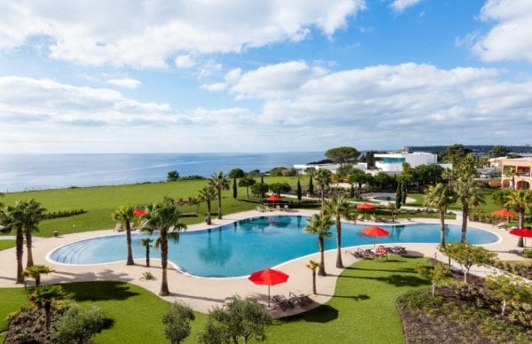Pool and garden with sea view at Cascade Wellness Resort