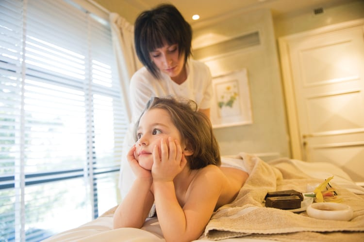 A child enjoying the Four Seasons Hotel Firenze family spa