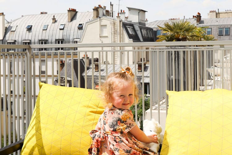 A baby girl enjoys the view at the Hotel De Sers in Paris