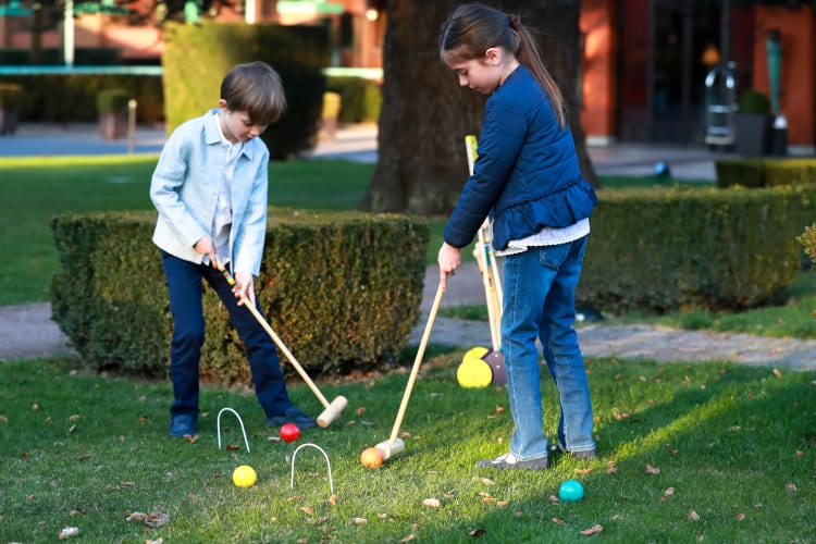 Kids playins croquet