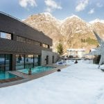 Mirtillo Rosso Family Hotel Outdoor swimming pool facing the mountains