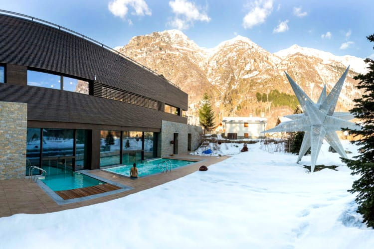 Outdoor pool surrounded by the snow