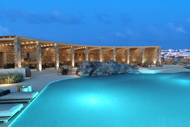 The Oniro Mykonos pool in Greece by night