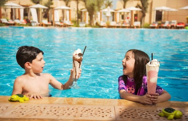 Saadiyat Rotana Resort and Villas Kids drinking  delicious milkshakes in the pool