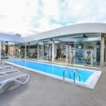 Baobab Suites swimming pool with deckchairs
