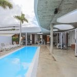 Fitness center with swimming pool at Baobab Suites