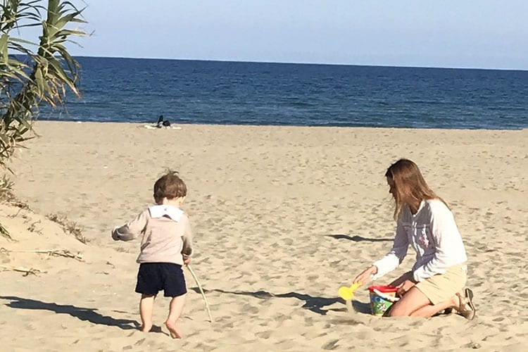 Natalia playing with her son on the beach