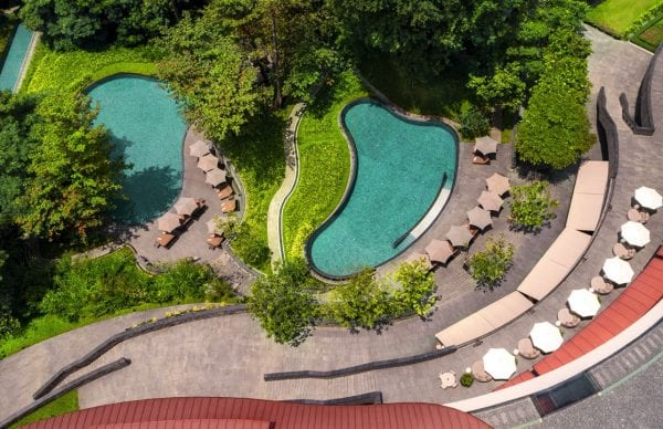 Outdoor pool of Capella Singapore seen from above
