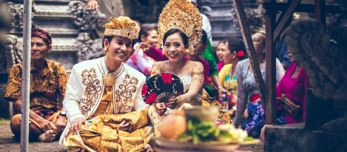 Couple during religious ceremony Bali Little Guest Hotels Collection