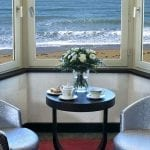 Grand Hôtel des Thermes double bedroom with sitting area overlooking the sea