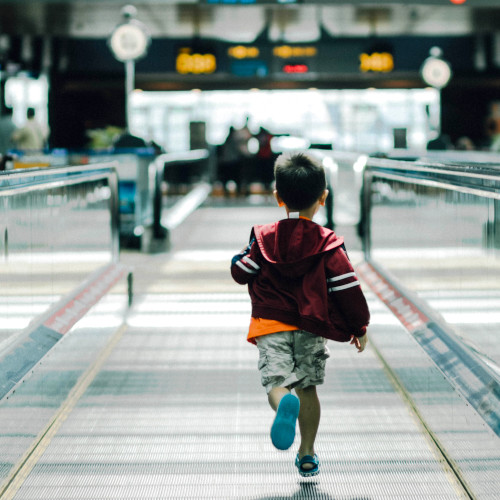 Child running in the airport