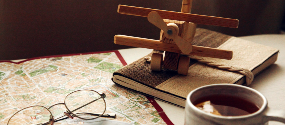 Wooden plane and world map